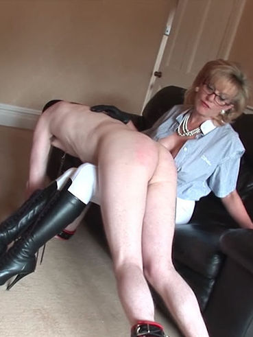 Gorgeous, big breasted Lady Sonia gets her sub to moan loudly during a long session of spanking.