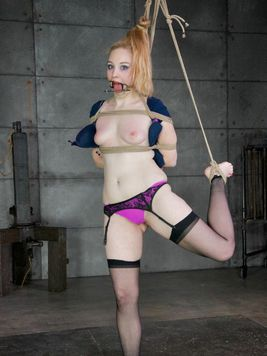 After getting her body teased and broken in kinky bondage Delirious Hunter sucks on feet.