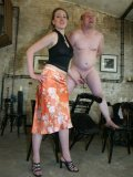 Nude middle aged man gets his cock and balls tortured by Lady K after spanking