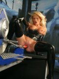 Blonde Nicoletta Blue in black latex gets double dildoed by man in gas mask