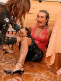 Crazy woman Tatiana Milovani and another clothed lady get wet and messy in the middle of the room