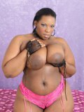 Fat big titted chocolate woman Crystal Clear with nice make removes her lingerie