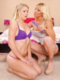 Blonde girl in red panties and blue jeans gets dominated by busty lesbian Britney Foster