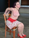 Slave lady in red shoes Caroline Pierce gets tied to chair and then spanked by femdom Sister Dee