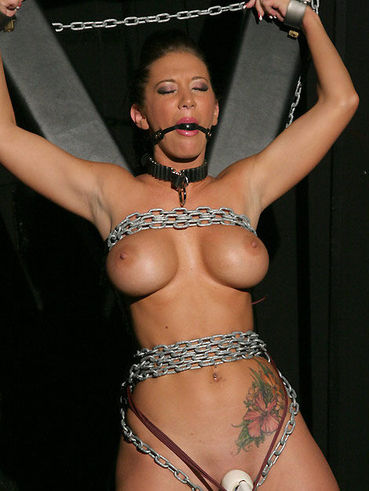 Perfect boobed bound brunette Jayden Jaymes enjoys the vibrator in the dungeon