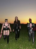 Bimba Sawacco in mask and latex suit gets dominated by Susi M and Lady K outdoors