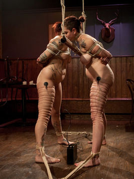 Rozen Debowe naked and has her small titted body stimulated and tazzed during lesbian bondage.