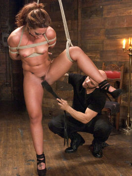 Red haired Savannah Fox gets into bondage and tight ropes while getting hardcore fucked.