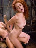Sexy natural redhead Sabrina Fox gets her snatch punished by dom Isis Love