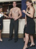 Wendy Taylor and other ladies play with dick of undressed man in the restaurant