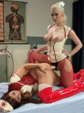 Mia Gold getting her horny slit rammed and stimulated with a strap-on by fetish expert Cherry Torn.