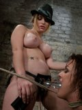 Sexy big boobed domina Aiden Starr gets pleasure punishing her juicy lesbian slave Sara Faye