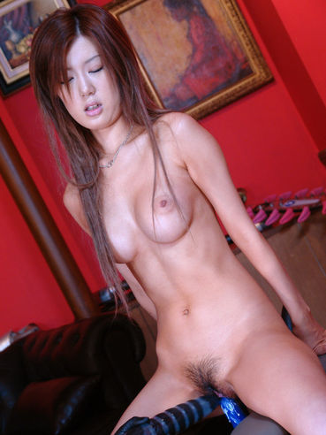 Naked brown haired asian Ichijo Aya with hairy pussy bounces up and down on dildo chair