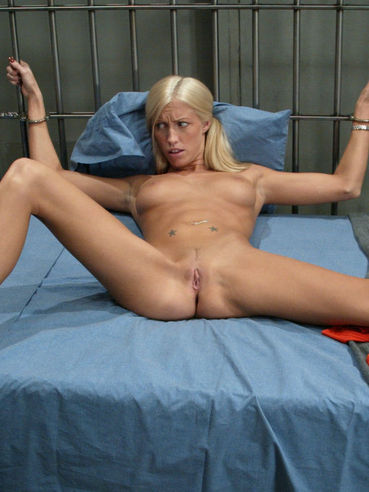 Blonde prisoner Cassie Young strips naked and gets handcuffed to be punished with drilldos.