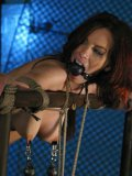 Red-haired slave girl Stella Red with weights on her tits gets her ass and pussy banged