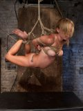 Blonde Mae Lynn hanging around in ropes then sucks cock while stimulated during bondage.