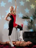 Blonde Lorelei Lee has her submissive man stepped on and rolled up in plastic wrap during femdom.