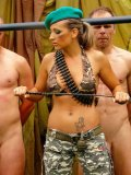 Uniformed military girl Gina Killmer trains two naked soldiers in the open air