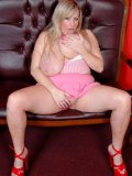 Fat blonde Leah Jayne dressed in pink has a good time masturbating with her red shoe