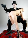 Naked brunette Jenna Hard with her bare juicy ass spanked by kinky clothed man
