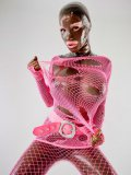 Bianca Beauchamp poses in skin tight latex body suit and pink fishnet outfit