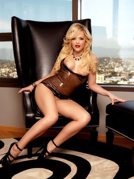 Leggy blond porn star Alexis Texas poses in rubber mini dress and high heels
