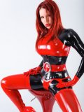 Auburn heartbreaker Bianca Beauchamp poses in red and black tight latex suit