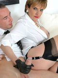 Dominating female in blouse, stockings and gloves Lady Sonia playing with hard stick