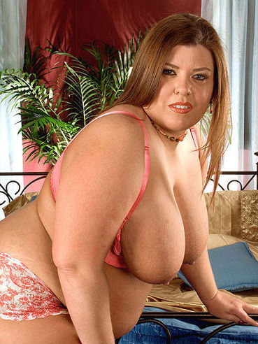 Brown haired chubby woman Karlee Adams in red lingerie demonstrates her assets