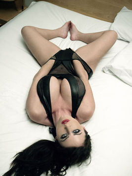 Sophie Dee loves to show off her feet and legs and that is what this gallery is about...
