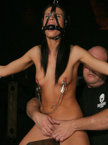 Slave brunette Jennifer Dark gets every inch of her slim body tortured with pegs and takes dildo