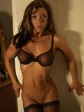 Hot bodied muscle woman Jennifer Searles in black lingerie bares her perfect round ass
