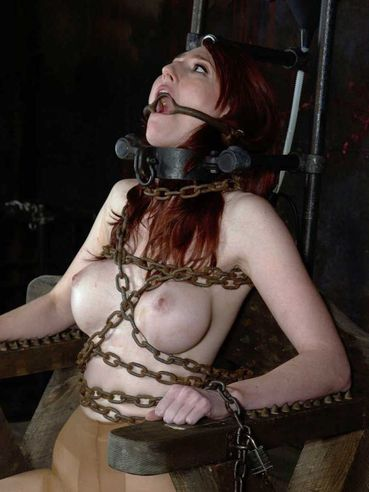 Round boobed leggy redhead girl Kendra Jame gets bound in the middle of the dungeon