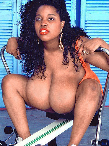 Chubby dark skinned chick in uniform Jenny Hill shows her big melons after doing exercises