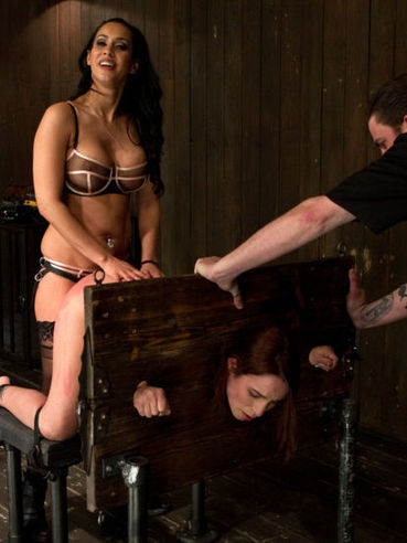 Redhead Amber Rayne gets on all four, her butt gets spanked and her asshole fisted.