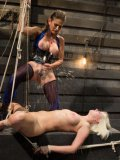 Felony dripping hot wax over Cherry Torn's delicate and pegged body during hot lesbian bondage.