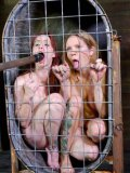 Bella Rossi naked and caged while her massive tits jiggle during bondage and hardcore dildoing.