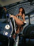 Hot woman Josy La Vine in black and white corset gets impaled on dildo device