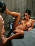 Masked imprisoned Damien gets his balls tied up and his anal hole fucked by brunette Cherokee