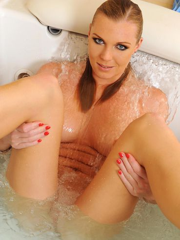 Leggy Ulrika with nice feet removes her black panties before taking a bath