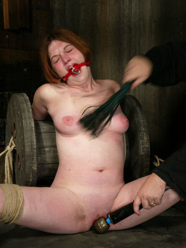 Sweet smooth skinned girl Ginger gets great bondage experience in the dungeon