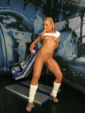 Bald pussy blonde Lucy Lain in white socks enjoys dildo machine standing up