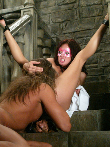 Sexy naked domina Tory Lane in mask gets her shaved pussy pleased by slave Phantom
