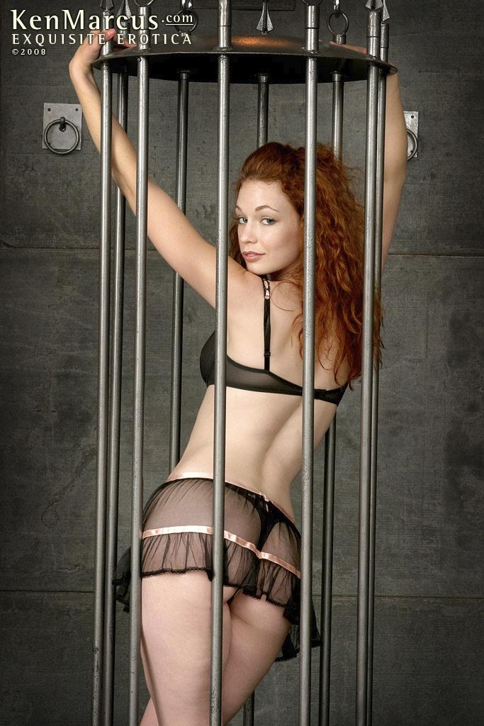 Justine Joli BDSM cage