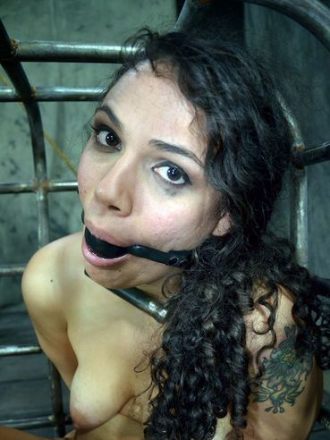 Slave girl Dixon Mason gets her asshole filled with dildo in suspension bondage