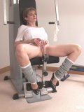 Lady Sonia keeping her mature fetish body fit while teasing and masturbating in a gym.