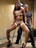 Ana Foxxx tied up and screaming while she is fed with a massive and throbbing cock during bondage.