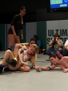A blonde hottie and her friends go up against tanned babe Isis Love while in a group in cat fight.