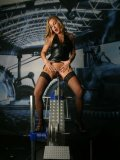 Nathalie in mesh stockings gives sex with dildo machine a try standing up