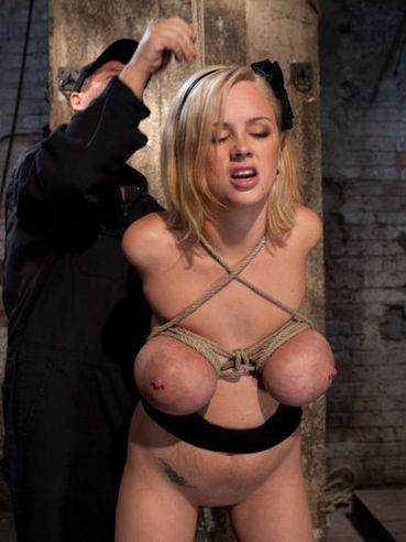 Sexy naked blonde Katie Kox with massive boobies gets rope bound in the dungeon